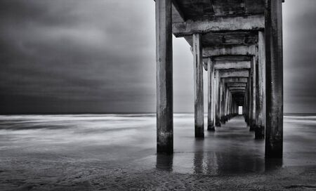 La Jolla beach, California,  long exposure under the pylons, black and white image. Banque d'images