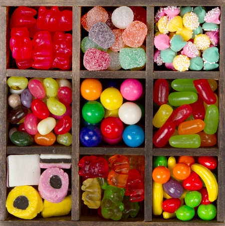 Gummy: assortment of candy for a background, nine types in a printers box.