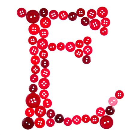 The letter E made of photographed buttons, isolated on a white background Stock Photo - 12503833