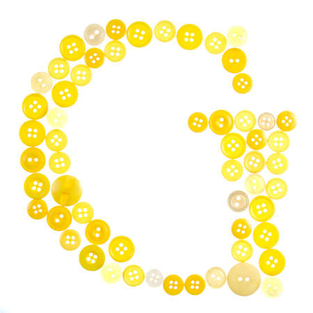 craft button: The letter G made of photographed buttons, isolated on a white background