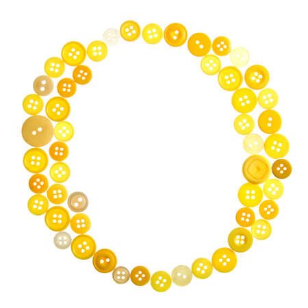 The letter O made of photographed buttons, isolated on a white background photo