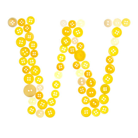 The letter W made of photographed buttons, isolated on a white background Stock Photo - 12503809