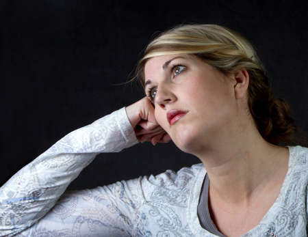 a woman with a depressed or thoughtful look on her face photo