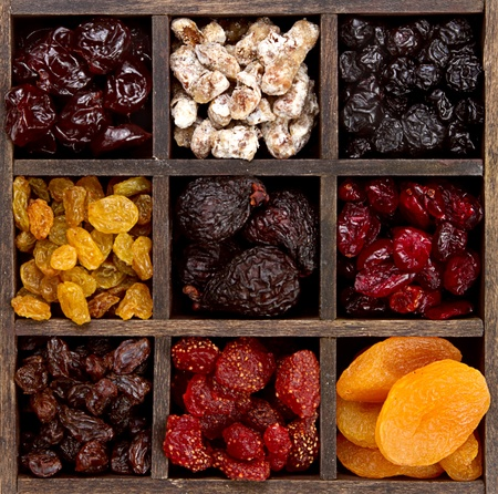 Assorted dried fruit arranged in a printers box photo