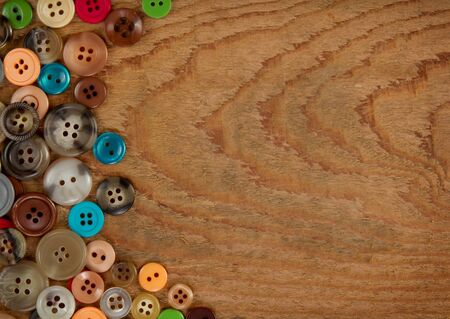 Assorted vintage sewing buttons on a wooded background, room for copy space Stock Photo - 12761701