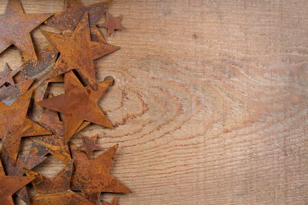 multiple stains: Rusty starts on a wooden background, room for copy space