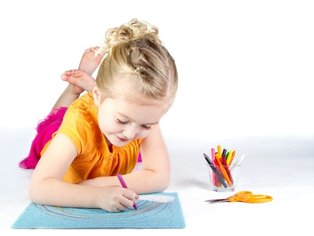 schemes: Little girl coloring a rainbow on white background