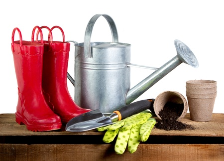 Gardening tools and red rubber boots isolated on a white background Foto de archivo
