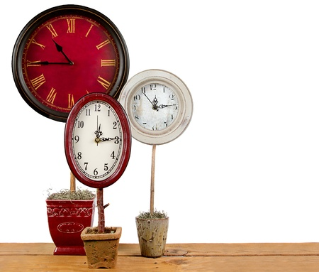 topiary: Clocks on a topiary, making more time concept.
