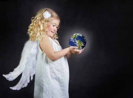 Angel child holding the world in her hands, elements of this image furnished by NASA photo