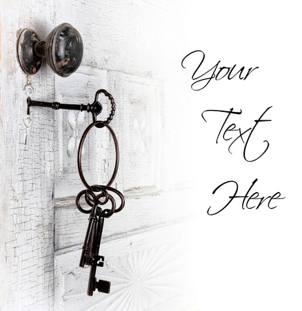 Antique door with keys in the lock isolated area for text