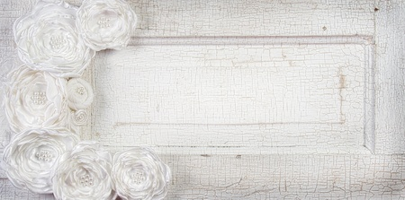 White Vintage flowers on an antique door for background