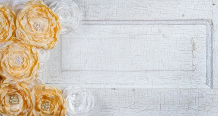 Yellow vintage flowers on an antique door,  photo