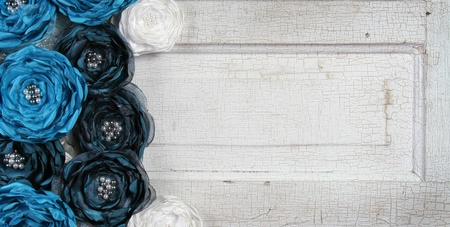 Blue vintage flowers on an antique door photo