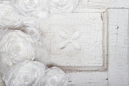 White Vintage flowers on an antique door for background Stock Photo - 13115883