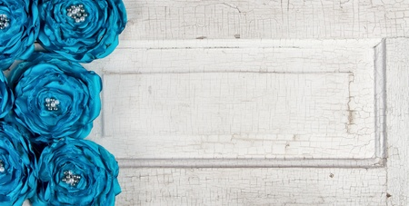 Blue vintage flowers on an antique door panel photo