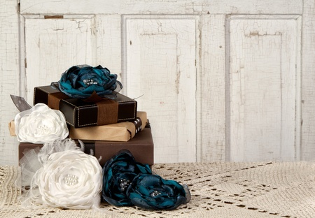 Wrapped vintage packages with vintage flowers against a vintage door