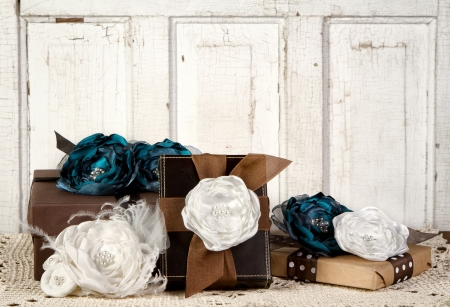 wedding gifts: Wrapped vintage packages with vintage flowers against a vintage door