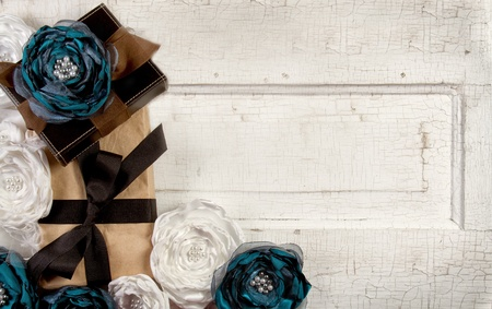 string of pearls: Wrapped vintage packages with vintage flowers against a vintage door