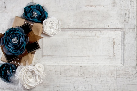 doiley: Wrapped vintage packages with vintage flowers against a vintage door