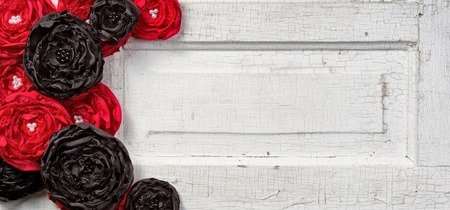 Black and Red shabby chic flowers on vintage door photo