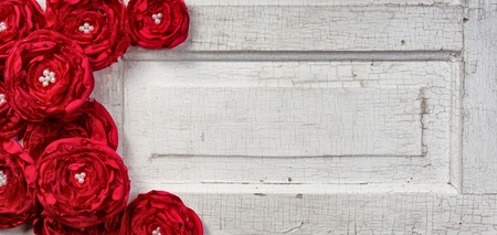 Red shabby chic flowers on vintage door photo