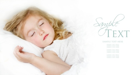 Sleeping child in white bedding room for copy space