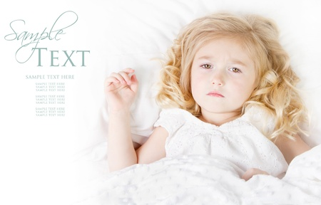 child in bed: Sick or Sad child preschool age in bed on white background