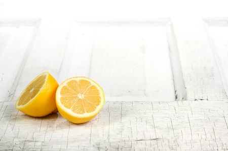 Lemon still life on a aged wooden background