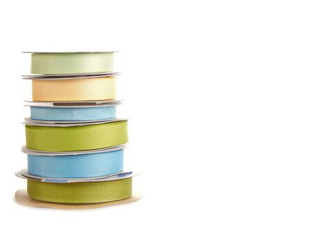 spools of ribbon stacked on white background Stock Photo - 13497989