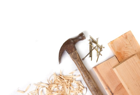 whack: Hammer, nails and boards on a white background