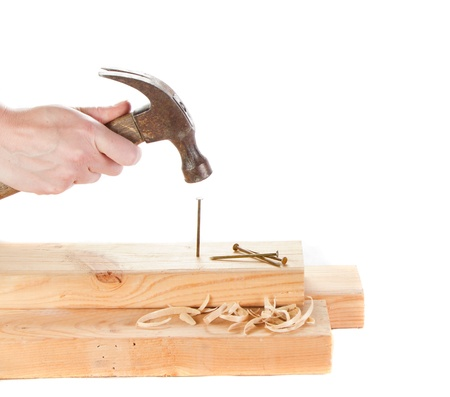 pounding head: Stiking a nail with a hammer isolated on white backgroun Stock Photo