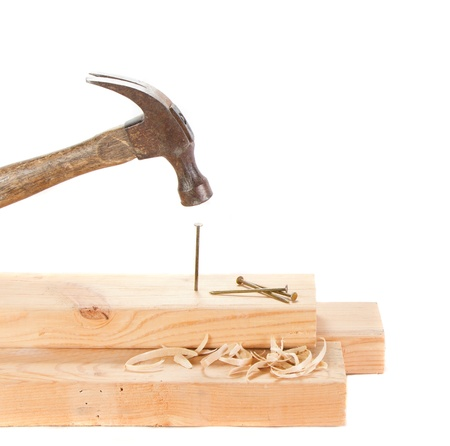 Stiking a nail with a hammer isolated on white background photo