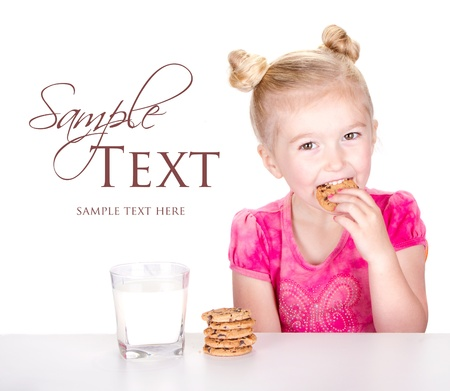 chocolate chip cookies: A cute little girl eating a chocolate chip cookie isolated on a white background