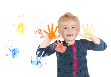 handprints: Little girl painting handprints on window, isolated on white background