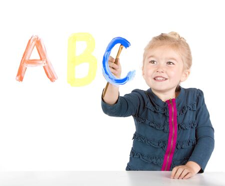 abc's: Little girl paints ABCs or letters on window