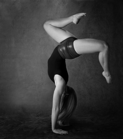 Girl doing back bend in black and white photo