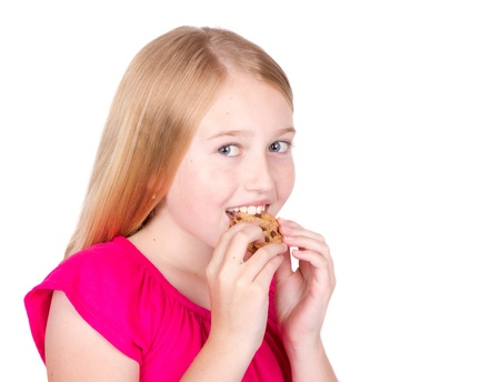 chocolate chip cookies: Girl eating chocolate chip cookie isolated on white background