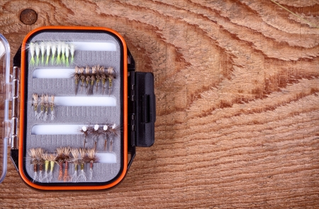 Collections of  flies in a tackle box for fly fishing Stock Photo