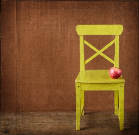 Apple sitting on classroom chair grunge texture photo
