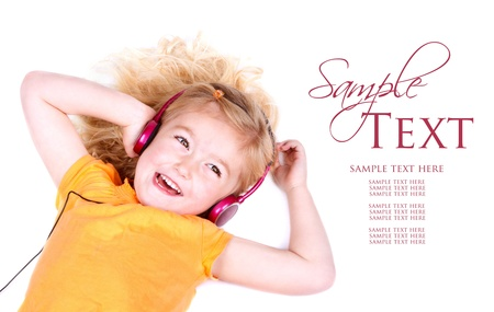 Young girl listening to music on headphones, on white background Foto de archivo
