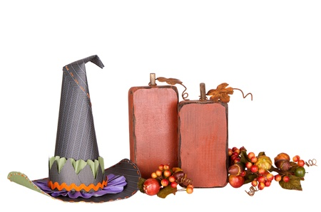 rick: Witches hat and decorative pumkins isolated on a white background Stock Photo