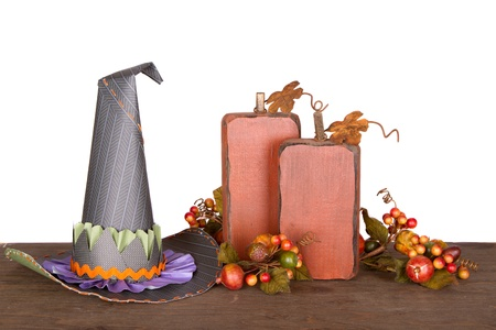 rick rack: Witches hat and decorative pumkins isolated on a wooded plank Stock Photo