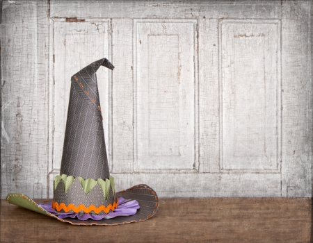 pointy: Witches hat with grunge background, and cracked vintage door Stock Photo