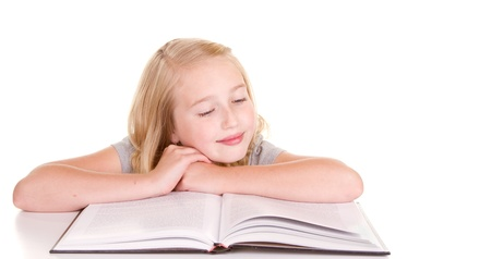 girl reading book: Older child or teenager reading book, isolated on white background