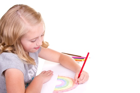 Older girl or teen drawing a rainbow with colored pencils photo