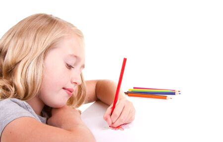 Older girl or teen drawing a flower with colored pencils photo