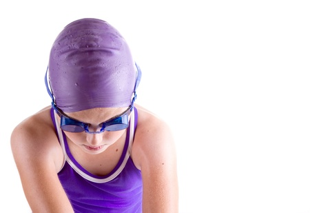 Determined young swimmer in dive pose photo