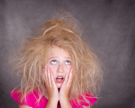 frizzy: Girl with crazy bed head or tangled hair Stock Photo