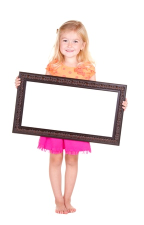 looking around: Child holding blank frame, isolated on white